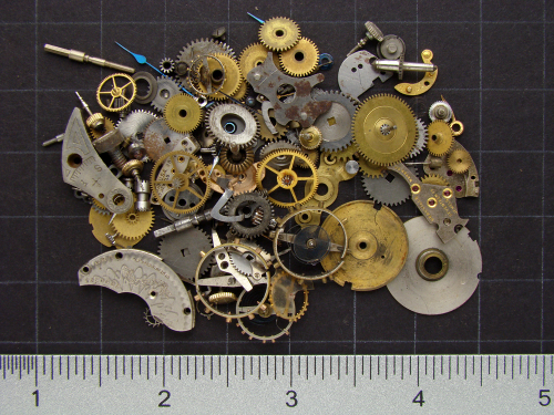 Etsy shop listings of mixed vintage brass gears and watch parts